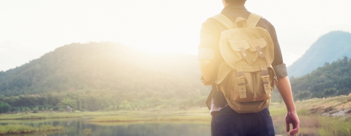 Young Man Traveler with Backpack